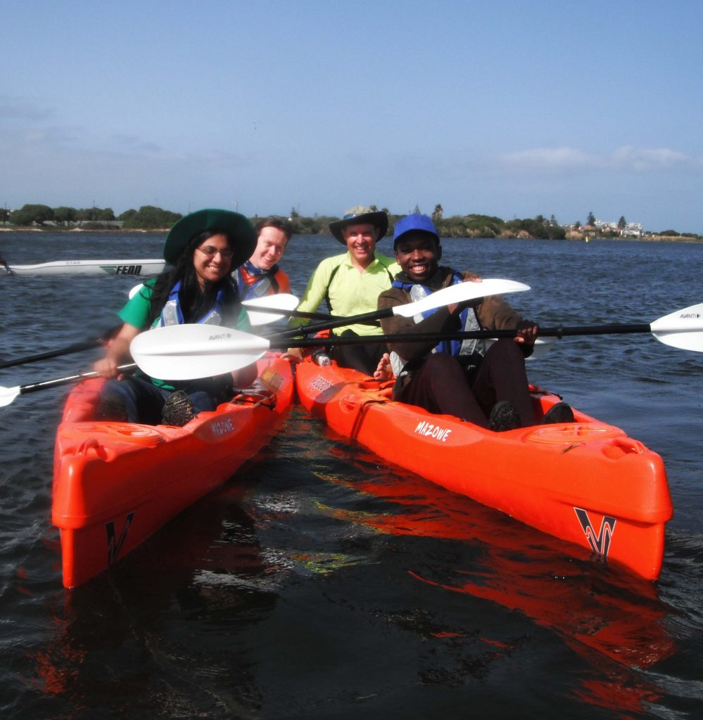 paddle experience - group fo happy paddlers in a paddle fit session.