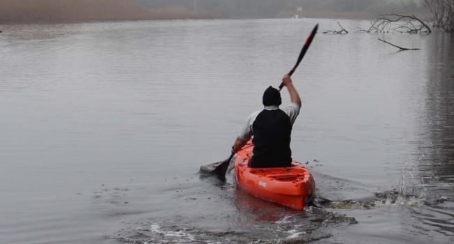 paddle experience - daniel exploring the vast expanse of the klein river, stanford.